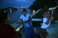 A family enjoys and evening alongside the Arauca River, which borders Colombia and Venezuela, in the Colombian city of Arauca on June 27, 2009. The border region between Colombia and Venezuela has often been a region with a high level of activity of illegal armed groups. (Photo/Scott Dalton)