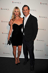 KATE MOSS and BERND BEETZ at a party hosted by Rimmel London to celebrate the 10 year partnership with Kate Moss held at Battersea Power Station, London SW8 on 15th September 2011.