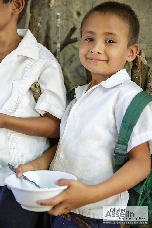 A boy waits to get served lunch at the primary school in the town of Coyolito, Honduras on Wednesday April 24, 2013.