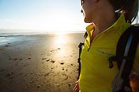Image of young woman watching sunset in Manzanita, Oregon.