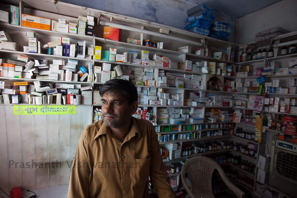 Sanjay Kapoor runs a chemist shop at less than a kilometers distance from the Primary Health Care Center, in Dhatrath, Jindh, India, on Saturday, April 10, 2010. Photographer: Prashanth Vishwanathan/Bloomberg