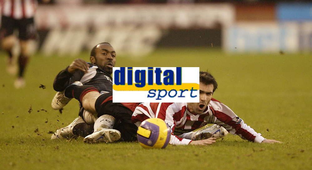 Photo: Aidan Ellis.<br /> Sheffield United v Manchester City. The Barclays Premiership. 26/12/2006.<br /> Sheffield's  Keith Gillespie feels the power of a tackle from City's Darius Vassell