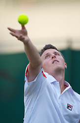 LONDON, ENGLAND - Thursday, June 24, 2010: Kenneth Skupski (GBR) serves during the Gentlemen's Doubles 1st Round match on day four of the Wimbledon Lawn Tennis Championships at the All England Lawn Tennis and Croquet Club. (Pic by David Rawcliffe/Propaganda)