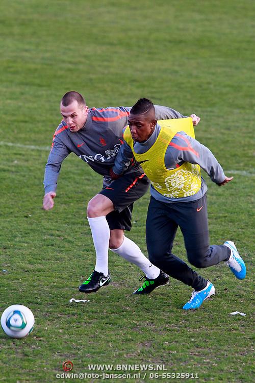 NLD/Katwijk/20110321 - Training Nederlandse Elftal Hongarije - NLD, John Heitinga en Elrijo Ellia in duel