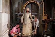 Napoli, Italia - Due volontari spostano una statua ella Madonna all'interno (spoglio) della chiesa del Gesu e Maria a Napoli.<br /> Ph. Roberto Salomone Ag. Controluce<br /> ITALY - Volunteers move a statue rapresenting the Virgin Mary inside the  Gesu e Maria church in Naples on July 25, 2013.