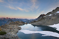 Ice floes on Wing Lake, Corteo Peak in the distance, North Cascades Washington