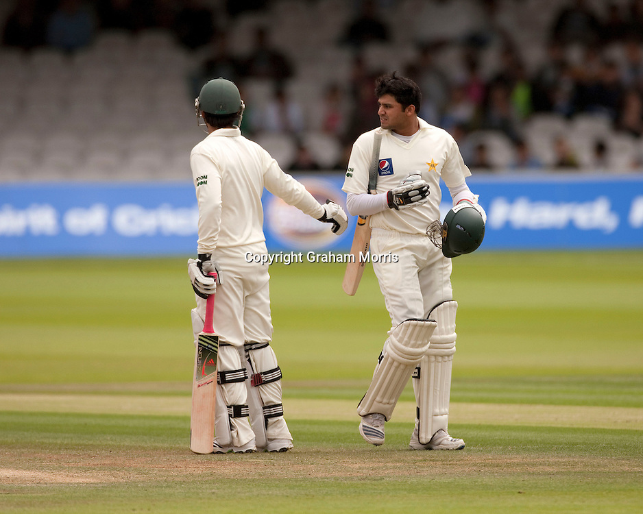 Azhar Ali (right) walks off after being caught off Ben Hilfenhaus during the MCC Spirit of Cricket Test Match between Pakistan and Australia at Lord's.  Photo: Graham Morris (Tel: +44(0)20 8969 4192 Email: sales@cricketpix.com) 16/07/10