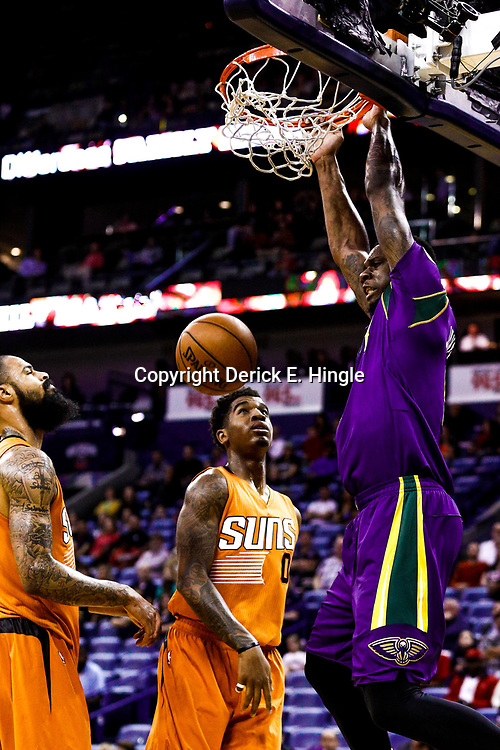 Feb 6, 2017; New Orleans, LA, USA; New Orleans Pelicans forward Terrence Jones (9) dunks over Phoenix Suns forward Marquese Chriss (0) and center Tyson Chandler (4) during the first quarter of a game at the Smoothie King Center. Mandatory Credit: Derick E. Hingle-USA TODAY Sports