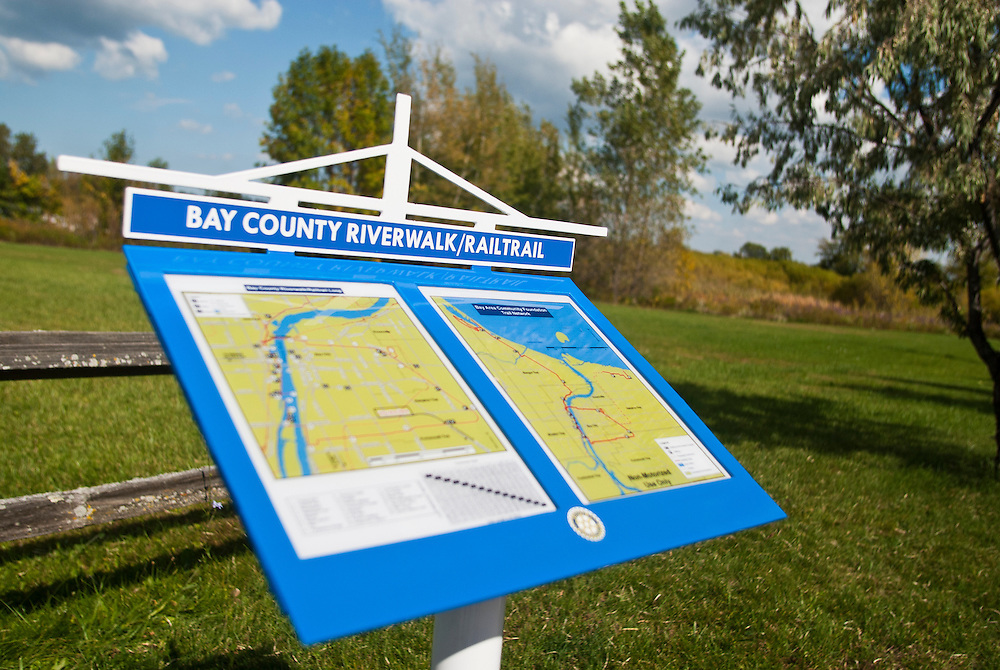 Lathan Goumas | The Bay City Times..A new sign showing the route along the Railtrail in Portsmouth Township, MI., on Tuesday September 27, 2011. The Bay Area Community Foundation recently installed nine new and replaced ten old signs that map out the route of the Riverwalk and Railtrail.