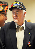 World War II Veteran, Robert K. Patterson (right) is presented with the Bronze Star Medal by State Director, Bob DeSousa (left), COL USAR JA at the Horsham Township Building Friday August 7, 2015 in Horsham, Pennsylvania. (Photo by William Thomas Cain)