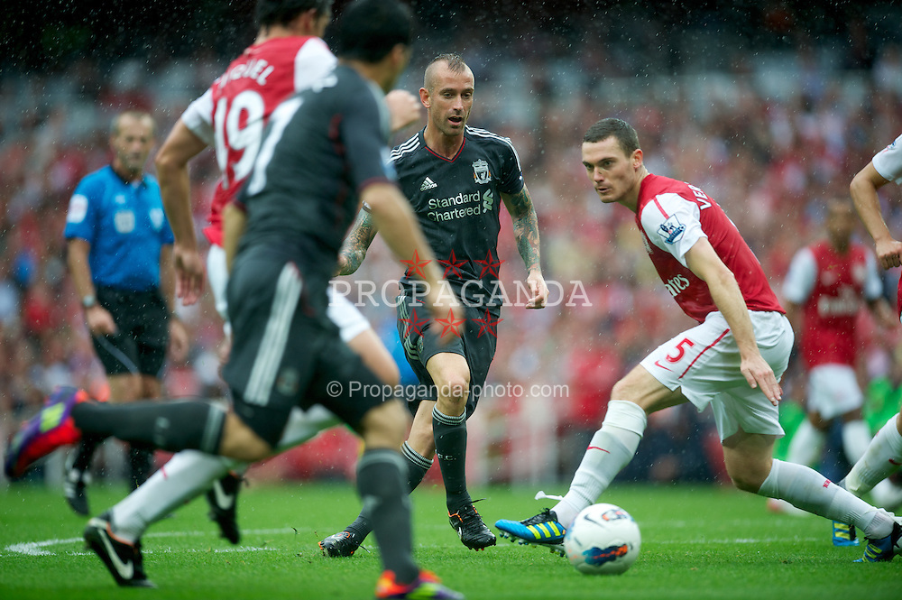 LONDON, ENGLAND - Saturday, August 20, 2011: Liverpool's Raul Meireles plays the ball through before his side's opening goal against Arsenal during the Premiership match at the Emirates Stadium. (Pic by David Rawcliffe/Propaganda)