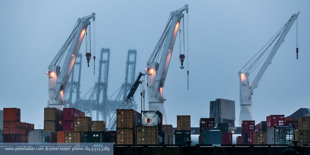 A soft and symmetrical rendition of cranes and containers on an Auckland wharf.