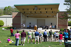 10 May 2014:  Bloomington Mayor Tari Renner at podium 25th anniversary celebration of the Constitution Trail ceremony at Connie Link Amphitheater in Normal Illinois