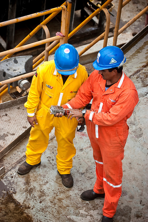 Safety workers checking for gasleaks on an Offshore oil drilling platform in the Gulf of Mexico