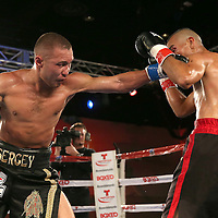 Sergei Lipinets (L) punches Cosme Rivera during a Telemundo Boxeo boxing match at the A La Carte Pavilion on Friday,  March 13, 2015 in Tampa, Florida.  (AP Photo/Alex Menendez)