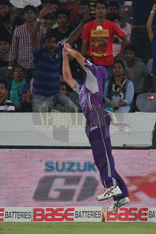 Ben HILFENHAUS of the Hobart Hurricanes  attempts a catch to prevent the six and save the match during the first semi final match of the Oppo Champions League Twenty20 between the Kolkata Knight Riders and the Hobart Hurricanes held at the Rajiv Gandhi Cricket Stadium, Hyderabad, India on the 2nd October 2014<br /> <br /> Photo by:  Ron Gaunt / Sportzpics/ CLT20<br /> <br /> <br /> Image use is subject to the terms and conditions as laid out by the BCCI/ CLT20.  The terms and conditions can be downloaded here:<br /> <br /> http://sportzpics.photoshelter.com/gallery/CLT20-Image-Terms-and-Conditions-2014/G0000IfNJn535VPU/C0000QhhKadWcjYs