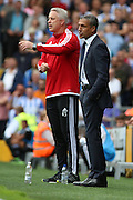 Kit Symons and Chris Hughton trying to inspire their teams during the Sky Bet Championship match between Fulham and Brighton and Hove Albion at Craven Cottage, London, England on 15 August 2015. Photo by Matthew Redman.