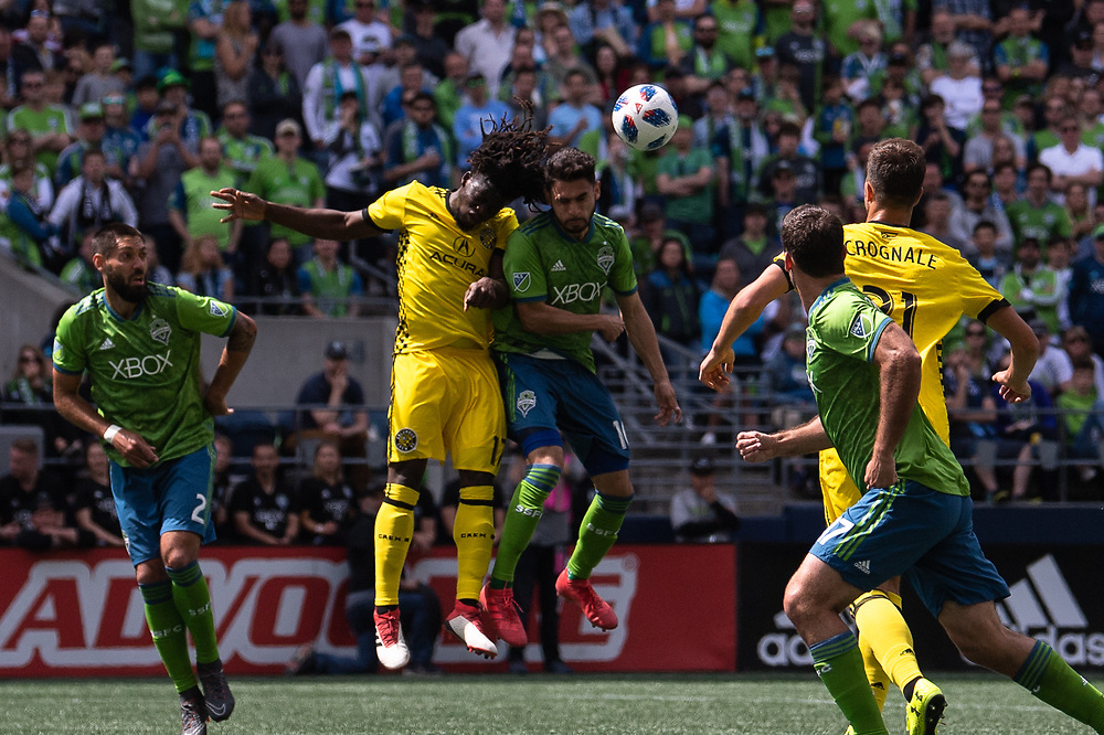 May 05, 2018; Seattle, Washington, US;  Seattle Sounders midfielder Alex Roldan (16) battles against Columbus Crew defender Lalas Abubakar (17) during in action between the Seattle Sounders FC and Columbus Crew at Century Link Field. Photo credit: Rick May - Rick May Photography