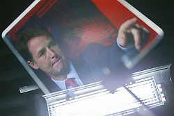 © Licensed to London News Pictures. 09/06/2014. LONDON, UK. Liberal Democrat party leader Nick Clegg's reflection is seen on a autocue screen whilst delivering a speech about party's long term vision in coalition and policies at Bloomberg in central London on Monday, 9 June 2014. Photo credit : Tolga Akmen/LNP