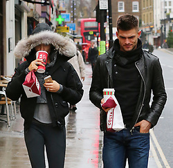 Strictly Come Dancing finalist Abbey Clancy wearing a fur hooded jacket, Stella McCartney leggings and trainers, grabs a morning coffee with dance partner Alijaz Skorjanec before rehearsals. London, UK. 16/12/2013<br />BYLINE MUST READ : JAMESY/GOTCHA IMAGES<br /><br />Copyright by © Gotcha Images Ltd. All rights reserved.<br />Usage of this image is conditional upon the acceptance <br />of Gotcha Images Ltd, terms and conditions available at<br />www.gotchaimages.com