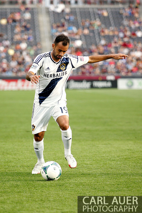 July 27th, 2013 - LA Galaxy midfielder  Juninho (19) sets up for a shot on goal in the second half of action in the Major League Soccer match between the LA Galaxy and the Colorado Rapids at Dick's Sporting Goods Park in Commerce City, CO