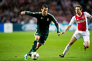 Real Madrid's Cristiano Ronaldo vies with Ajax Amsterdam's  Daley Blind during the UEFA Champions League Group D football match Ajax Amsterdam vs Real Madrid on October 3, 2012 AFP PHOTO/ ROBIN UTRECHT.