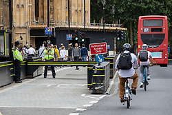© Licensed to London News Pictures. 15/08/2018. London, UK. Security barriers outside the Houses of Parliament, where a car crashed on Tuesday 14 August 2018 after hitting several cyclists. The driver, named as 29-year-old Salih Khater, is being held on suspicion of terrorism. Photo credit: Rob Pinney/LNP