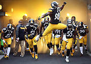 Pittsburgh Steelers inside linebacker Vince Williams (98) leaps in the air and yells as he pumps his fists while leading a group of Steelers players out of the tunnel and onto the field for the NFL week 16 regular season football game against the Kansas City Chiefs on Sunday, Dec. 21, 2014 in Pittsburgh. The Steelers won the game 20-12 and clinched an AFC playoff spot. ©Paul Anthony Spinelli