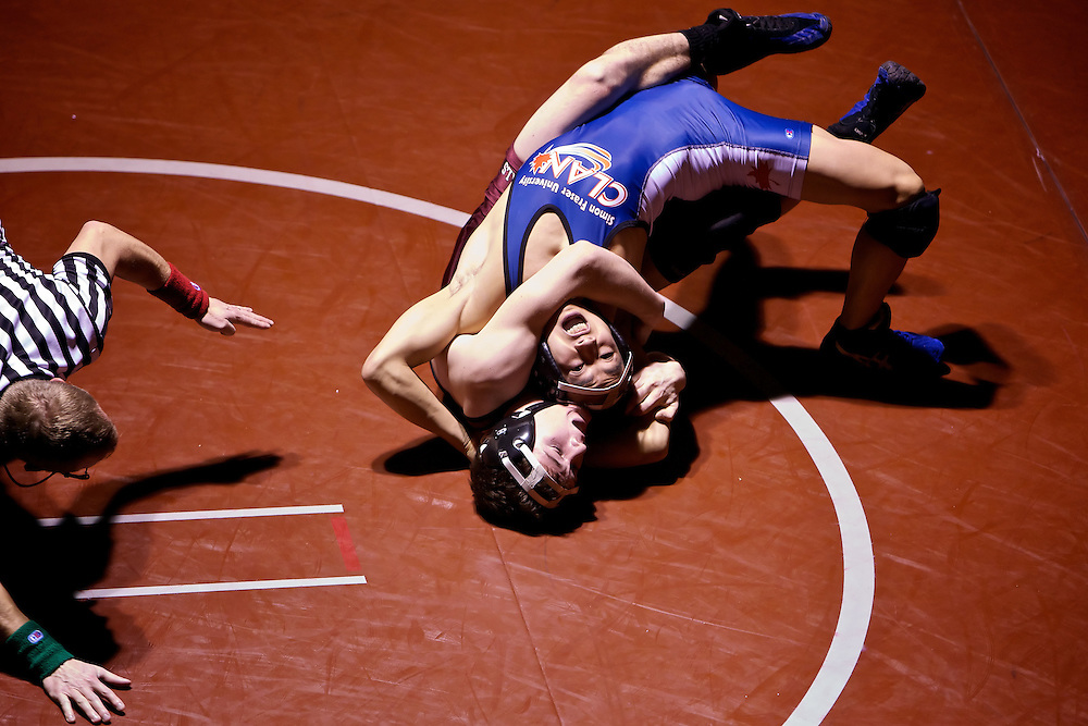 North Idaho College's Braden Mowry tries to roll JJ Lum from Simon Fraser University into position for a pin during the 141-pound match Friday. Mowry couldn't get the pin, but he won the match by major decision.