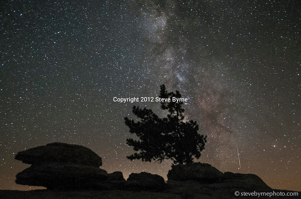 A meteor burns through the atmosphere atop Sentinel Dome. Yosemite National Park, California.