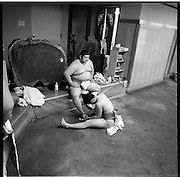 apprentice attends a older wrestler.Morning  workout session in the Sado Gatake stable, 30 minutes west of Tokyo, .