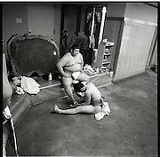 apprentice attends a older wrestler.Morning  workout session in the Sado Gatake stable, 30 minutes west of Tokyo, .