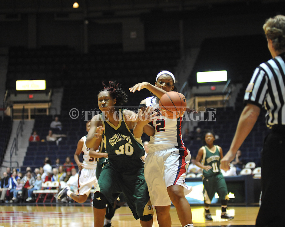 Ole Miss'  Monique Jackson (42) and Southeastern Louisiana's Nanna Pool (30) vie for the ball in Oxford, Miss. on Friday, November 9, 2012. (AP Photo/Oxford Eagle, Bruce Newman)