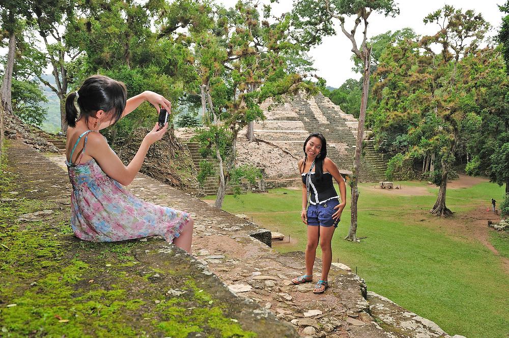 Two local girls,UNESCO World Heritage Site,Parque Archeologico Copan, Copan Ruinas, Central America, Honduras.Model release 0210,0211