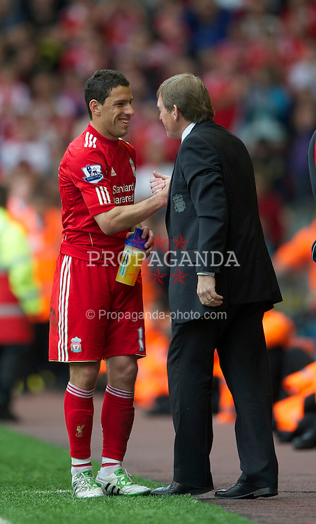 LIVERPOOL, ENGLAND - Saturday, April 23, 2011: Liverpool's manager Kenny Dalglish MBE congratulates hat-trick hero Maximiliano Ruben Maxi Rodriguez during the Premiership match at Anfield. (Photo by David Rawcliffe/Propaganda)