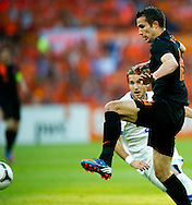 In action for   Robin van persie   The Netherlands versus Peter Pakarik     Slovakia during friendly soccer match between Netherlands vs Slovakia in Rotterdam on May 30, 2012. AFP PHOTO/ ROBIN UTRECHT