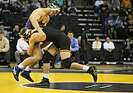 December 8, 2011: Northern Iowa Panthers Ryan Loder tries to hold off Iowa Hawkeyes Vinnie Wagner in the 184 pound bout of the NCAA wrestling dual between the Northern Iowa Panthers and the Iowa Hawkeyes at Carver-Hawkeye Arena in Iowa CIty, Iowa on Thursday, December 8, 2011. Loder defeated Wagner 13-2 and Iowa defeated Northern Iowa 38-4.