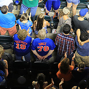 Fans during the seventh inning stretch during the New York Mets V Arizona Diamondbacks Major League Baseball game  at Citi Field, Queens, New York. USA. 3rd July 2013. Photo Tim Clayton