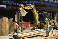 NYC, New York, U.S.  21st May 2013.  Construction workers are working at site in the heart of Times Square, during a pleasant spring day, with a high of 86ºF/32ºC, in Manhattan.