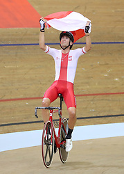 Poland's Wojciech Pszczolarski celebrates winning the Gold Medal in the Mens 40km Points Race during day four of the 2018 European Championships at the Sir Chris Hoy Velodrome, Glasgow.