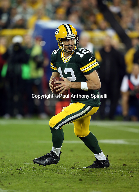 Green Bay Packers quarterback Aaron Rodgers (12) drops back to pass during the 2015 NFL week 3 regular season football game against the Kansas City Chiefs on Monday, Sept. 28, 2015 in Green Bay, Wis. The Packers won the game 38-28. (©Paul Anthony Spinelli)