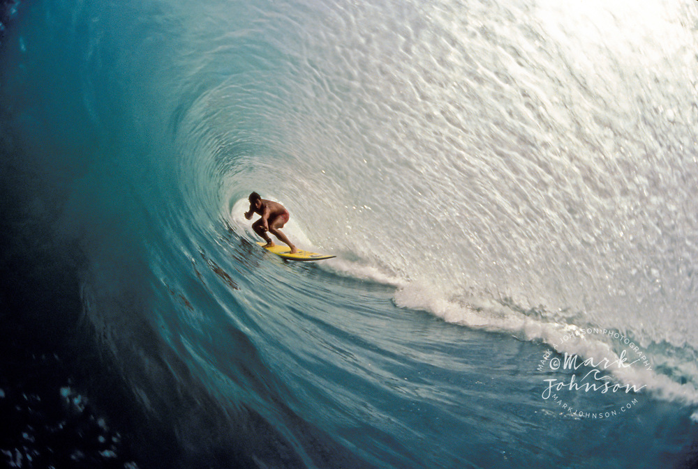 Surfer deep in a Bali tube, Kuta Beach, Bali, Indonesia ****Model Release available