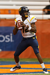 Oct 21, 2011; Syracuse NY, USA;  West Virginia Mountaineers quarterback Geno Smith (12) warms up before the game against the Syracuse Orange at the Carrier Dome.  Syracuse defeated West Virginia 49-23. Mandatory Credit: Jason O. Watson-US PRESSWIRE
