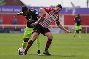 forward Vadaine Oliver tangles with defender Danny Butterfield during the Sky Bet League 2 match between Exeter City and York City at St James' Park, Exeter, England on 22 August 2015. Photo by Simon Davies.