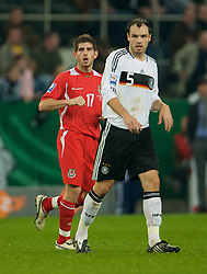 MONCHENGLADBACH, GERMANY - Wednesday, October 15, 2008: Wales' Ched Evans and Germany's Heiko Westermann during the 2010 FIFA World Cup South Africa Qualifying Group 4 match at the Borussia-Park Stadium. (Photo by David Rawcliffe/Propaganda)