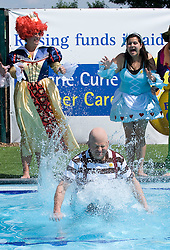 © licensed to London News Pictures. 21/05/2011. London, UK.  Adrian Chiles jumps into the water at The Park Club, Acton while taking part in an underwater tea party to launch Marie Curie Cancer Care's nationwide Blooming Great Tea Party. See special instructions for magazine rates. Photo credit should read London News Pictures