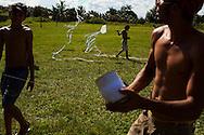 Junco do Maranhao, Brazil, June 26 of 2013:  Bolsa Familia em Junco do Maranhao. Homem e crianças passam a tarde de quarta-feira empinando pipa em campo de futebol. (photo: Caio Guatelli)