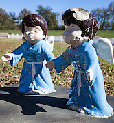 Funereal art adorns a plot at St. Raphael Cemetery on River Road near Plaquemine, Louisiana