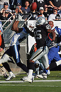 OAKLAND, CA - DECEMBER 19:  Wide receiver Derrick Mason #85 (caught 9 passes for 121 yards and a touchdown) of the Tennessee Titans stretches backwards to catch an over the head pass while defended by cornerback Denard Walker #25 of the Oakland Raiders at Network Associates Coliseum on December 19, 2004 in Oakland, California. The Raiders defeated the Titans 40-35. ©Paul Anthony Spinelli *** Local Caption *** Derrick Mason;Denard Walker