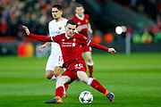 Liverpool defender Andy Robertson (26) with a shot during the Champions League semi final leg 1 of 2 match between Liverpool and Roma at Anfield, Liverpool, England on 24 April 2018. Picture by Simon Davies.